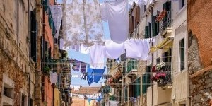Typical clotheslines in small street of Naples